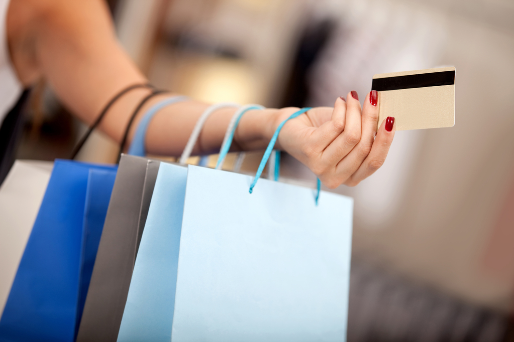 woman-with-shopping-bags-and-credit-card.jpg